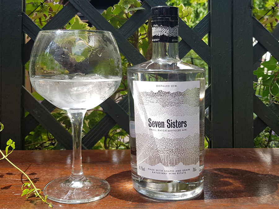 A bottle and glass of Seven Sisters Gin sparking i the sunlight - the perfect Sussex Gin