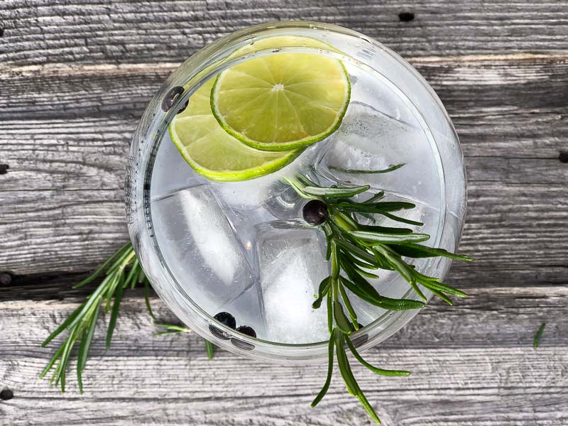 Sussex Gins - top view of Gin and tonic with lime, ice and rosemary